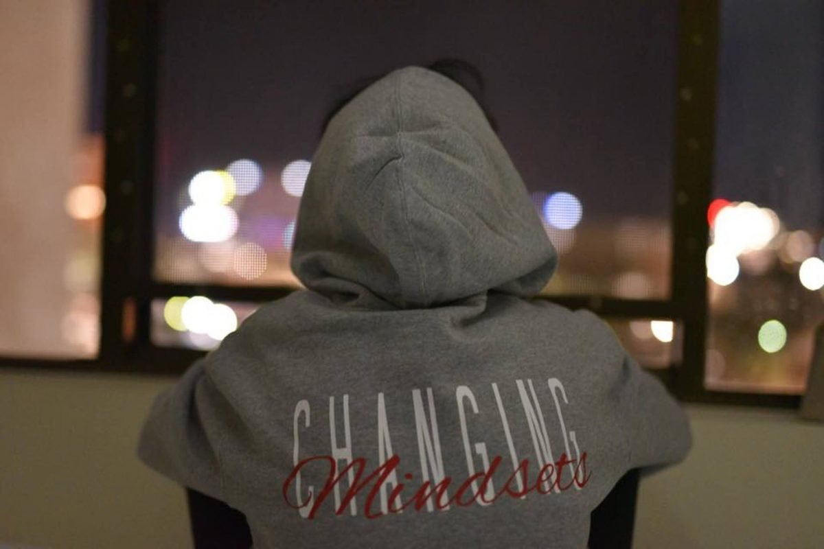 boy in hoodie with 'changing mindset' on back